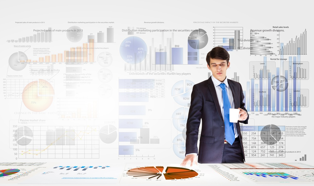 Young businessman and statistics information at background.jpeg